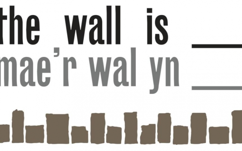 The Wall Is_____ logo